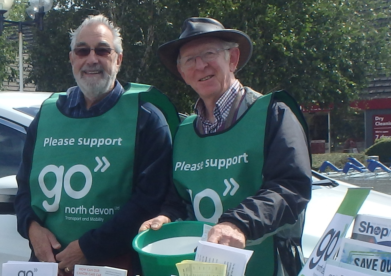 A group photo of Go North Devon volunteers holding collection buckets.