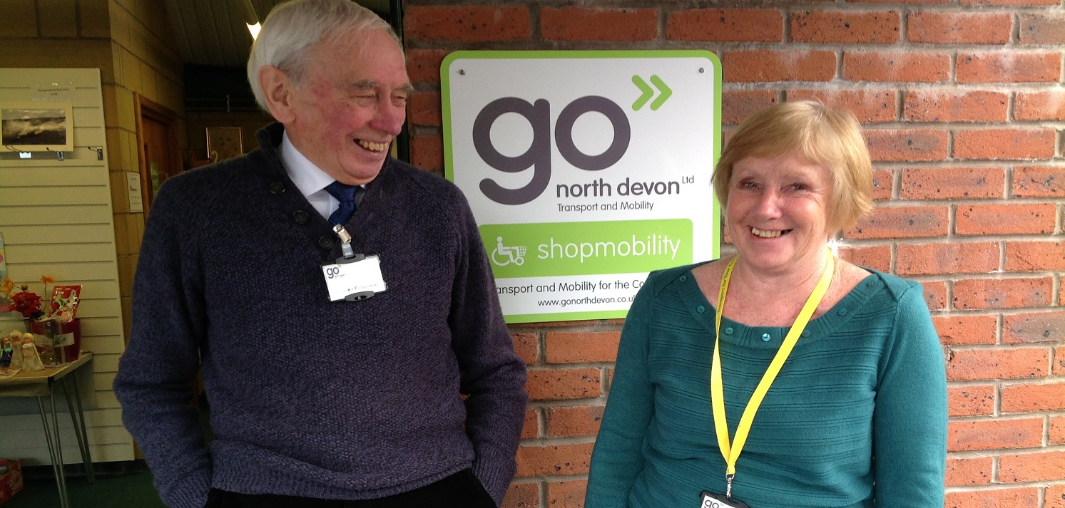 A Go North Devon employee selling a donated item to a customer to raise charity funds